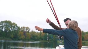 Father and son fishing on the lake stock video footage