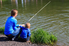 Father and son fishing on the lake Royalty Free Stock Photo