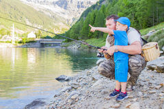 Father and son fishing in a mountain lake. A father and son fishing in a mountain lake Royalty Free Stock Image