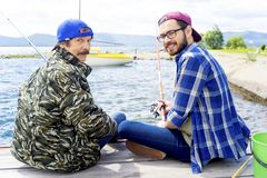 Father and son fishing. A portrait of father fishing with his son Royalty Free Stock Photos