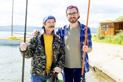 Father and son fishing. A portrait of father fishing with his son Royalty Free Stock Photo