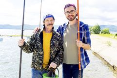 Father and son fishing. A portrait of father fishing with his son Stock Photos