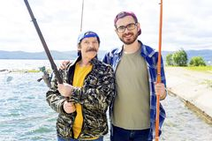 Father and son fishing. A portrait of father fishing with his son Stock Image