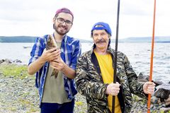 Father and son fishing. A portrait of father fishing with his son Royalty Free Stock Image