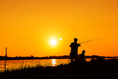 Father and son fishing in the river Royalty Free Stock Photography
