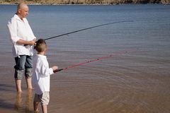 Father son fishing side view Royalty Free Stock Images