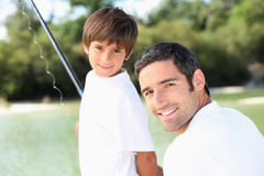 Father and son fishing together. Father and son on a fishing trip together Stock Photos