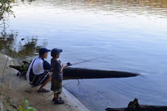 Father and son fishing. Together on a river Royalty Free Stock Photo