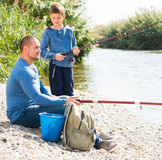 Father and son fishing in wild river Stock Image