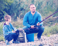 Father and son fishing in wild river Royalty Free Stock Photo