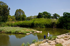 Father and son fishing. In Yarkon River. Tel aviv,Israel Royalty Free Stock Photos