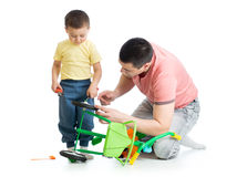 Father and son fixing bike Royalty Free Stock Image