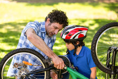 Father and son fixing the bike Royalty Free Stock Photo