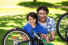 Father and son fixing the bike Royalty Free Stock Photography