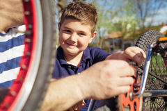 Father and son fixing bike Royalty Free Stock Images
