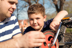 Father and son fixing bike Royalty Free Stock Photo