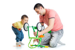 Father and son fixing repairing bicycle wheel Royalty Free Stock Images