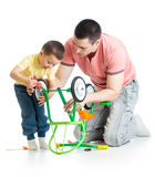 Father and son fixing repairing bicycle wheel Royalty Free Stock Photos
