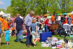 Father son flea market Kingsday, Netherlands Royalty Free Stock Photos