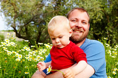 Father and son in flowers Royalty Free Stock Images