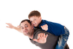 Father and son flying. Happy father and son flying isolated on white background Stock Photos