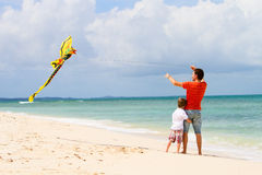 Father and son flying kite royalty free stock photos