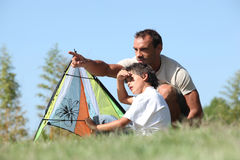 Father and son flying kite. Father and son flying a kite royalty free stock photography