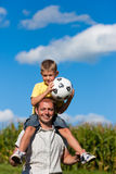 Father and son with football Stock Photography