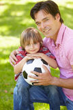 Father and son with football Royalty Free Stock Photo