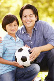 Father and son with football Royalty Free Stock Photos