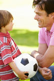 Father and son with football Royalty Free Stock Photography