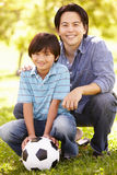 Father and son with football Royalty Free Stock Image