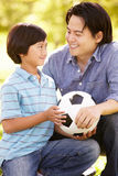 Father and son with football Stock Image