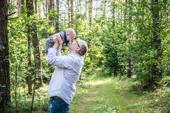 Father and son in forest happy Stock Images