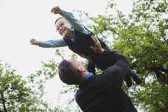 Father and son in forest on a meadow. A Father and son in forest on a meadow royalty free stock images