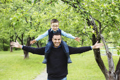 Father and son in forest on a meadow. A Father and son in forest on a meadow stock photography