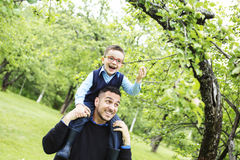 Father and son in forest on a meadow. A Father and son in forest on a meadow royalty free stock photo