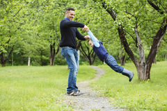 Father and son in forest on a meadow. A Father and son in forest on a meadow royalty free stock image