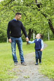 Father and son in forest on a meadow. A Father and son in forest on a meadow stock photo