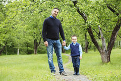 Father and son in forest on a meadow Stock Photos