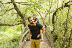 Father and son in forest on a meadow. A Father and son in forest on a meadow royalty free stock photos