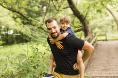 Father and son in forest on a meadow. A Father and son in forest on a meadow stock photos