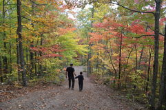 Father and son on forest path Royalty Free Stock Photos