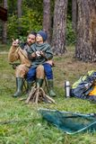 Father and son in forest. Father and son sitting in camping in forest Royalty Free Stock Photography