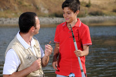 Father with son and free time. Operation fishing Stock Images