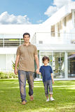 Father and son in front of house Stock Photography