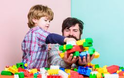 Father son game. Father son create constructions. Father and boy family leisure. Father leader showing boy how grow into stock photography