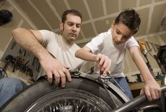 Father and son in garage Royalty Free Stock Photos