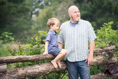 Father and Son in Garden Royalty Free Stock Photos