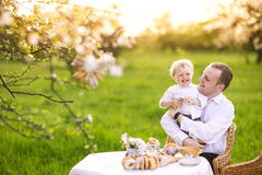Father with a son in the garden Royalty Free Stock Photo